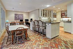 You can see how wonderfully open the kitchen/breakfast pom and den/study area are. Note the pretty brick floors in the breakfast area. This is a great space for family and guests to sit and chat with the chef.