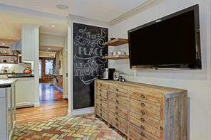 The chalkboard says it all- There is no place like home- especially when it's this one! This is a view from the breakfast room looking towards the front door.The TV is strategically placed for breakfast room and kitchen viewing.
