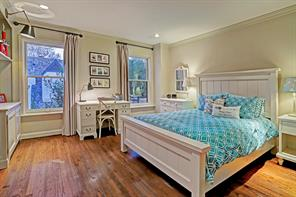 This large secondary bedroom has pretty wood floors and lovely built-ins.
