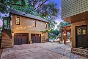 This is the view from the backyard looking towards the breakfast room. The exterior lighting including the Bevolo lanterns and the fire pit will be the hit of the party.