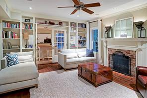 The family room is off the entry hall and near the kitchen/breakfast room.  It opens via French doors to the sunroom/study/project room. Note all the wonderful built-ins and the charming fireplace.