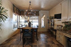 Breakfast room with built-in desk that opens out to covered patio.  Light fixture stays with the kitchen.