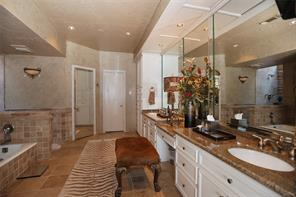Master bath has whirlpool tub, walk-in shower, his/her vanities, his/her closets and separate water closet.