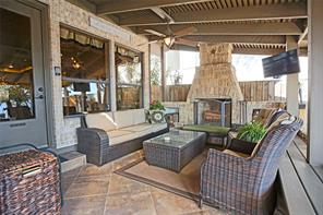 Covered patio with wood burning fireplace located right outside the kitchen for those intimate gatherings for all the seasons.