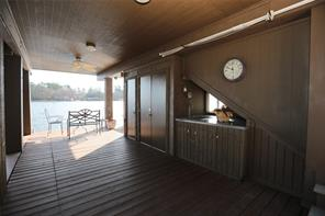 Boat house with electric boat slip, new storage closets and even a sink to clean all those fish you catch.