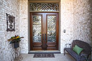 Enter 147 Lake View Circle through these exquisite leaded glass mahogany doors that also have a remote shade for that afternoon west sun.