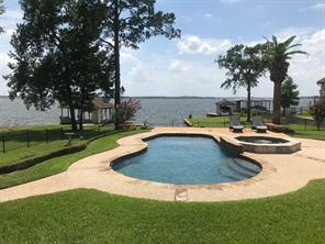 Welcome Home to your own private resort! One of the most amazing views on all of Lake Conroe, past the islands all the way to the distant Western shoreline