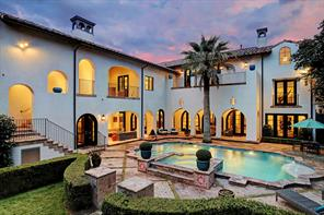 BACKYARD OASIS with heated pool & spa, and multiple fountains.  Notice the Cantera tile surround and accents, and the beautifully manicured landscaping.