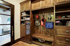 MUD ROOM WITH LOCKERS has site-built alder furniture-like cabinets & drawers.  There is a convenient seat for putting on and removing shoes.