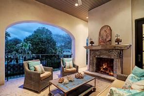 PRIVATE MASTER TERRACE with a hand carved Cantera stone fireplace, Cantera stone flooring, custom iron railing and a private staircase to the pool & spa.  Just lovely!
