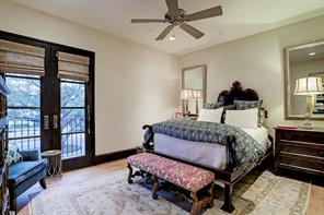 SECONDARY BEDROOM has hardwood floors, French doors opening to a private balcony, and ample space for large-scale furniture.