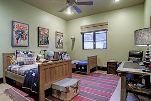 SECONDARY BEDROOM with softly painted walls & ceiling, hardwood flooring, walk-in closet and an en-suite bathroom.