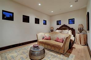 The spacious CASITA OR SECONDARY BEDROOM has clerestory windows, hardwood flooring and recessed lighting.