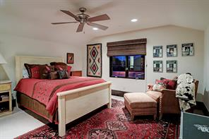 SECONDARY BEDROOM with an en-suite bathroom and closet has a raised ceiling, carpeted floor and large casement windows.