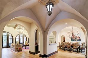 FOYER looking toward FORMAL DINING ROOM, FAMILY ROOM & WET BAR.  Notice the extraordinary ceiling detail.