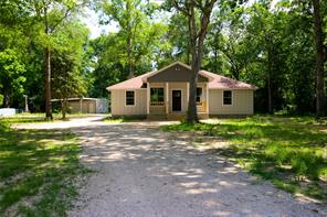 One Story 3/2/2 car carport with garage on 1 acre UNRESTRICTED..