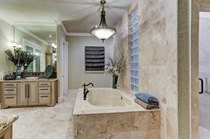 Master bathroom has double sinks with separate vanities, a stunning stone jetted tub and shower.