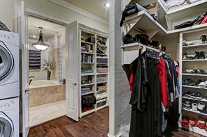 The enormous walk-in closet has an abundance of storage space and custom shelves. There is a dedicated utility room but also washer and dryer hook ups conveniently in the walk-in closet.