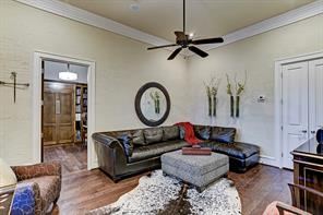 The den area has gorgeous wood floors throughout, high ceilings, distinct crown moulding and access to the study.
