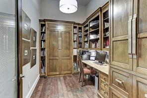 The private study is surrounded by wooden built-in bookshelves, dazzling granite counter tops, rich wood floors and plenty of room for books. Found in the study is a Murphy bed in the cabinet.