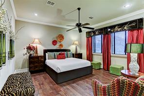 Large secondary upstairs guest bedroom suite which contains an enormous amount of natural lighting.