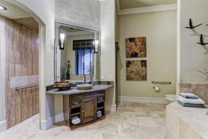 Upstairs full bathroom with elongated walk through shower, separate vanity with granite counter tops and tiled tub.