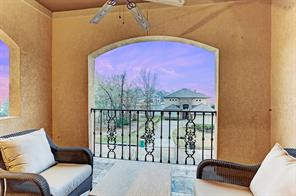 The upstairs has two private covered balconies with stunning views of Lake Conroe.