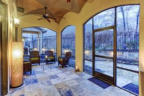 The outdoor covered screened patio is accessed via the living room.