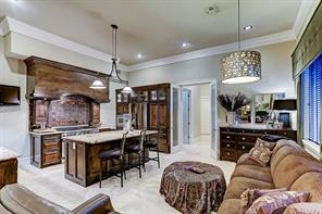 Custom wood finishes, bright granite countertops, gas range stovetop and breakfast bar are highlights of the spacious kitchen. There is an entire room designed as a chef's panty with wine cooler and bar.