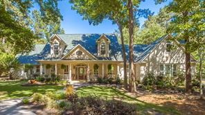 Welcome to 27202 Winding Creek.,   situated on 1.988 wooded acres in Indigo Ranch.