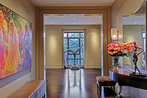 The gracious FRONT FOYER (35 X 8) is detailed with Ipe Brazilian walnut hardwood flooring and a large window framed by stepped out pockets. The flush baseboard with reveal and the 10 foot ceiling adds further to the serene and spacious ambiance of the well planned space.