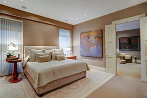 Opening from the Study's double doors is the MASTER BEDROOM SUITE (15 X 14) with its softly painted walls, hand tufted wool carpeting, automated retractable shades and vertical blinds, Donghia paper backed fabric wall coverings, recessed lighting and sliding glass doors to the balcony.