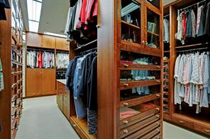 Still another view of the CLOSET with its glass front cabinets and hanging compartments.