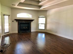 Large master bedroom with patio access and fireplace.  Check out the amazing ceiling!