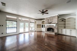 Spacious family room with views of the beautiful pool and trees.