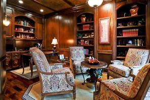 Handsome STUDY located to the right of the ENTRY has walnut floor, block paneled walls, built in desk with file drawers and upper bookshelves, additional built in bookcases and faux finished ceiling.  Recessed and incandescent lighting plus sconces too!