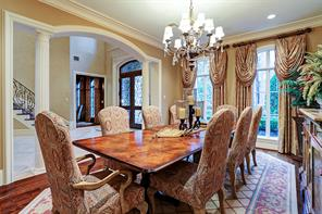A view of the DINING ROOM (19 X 13) from the Butler's Pantry toward the archway to the 2-story Entry and Study.  Classic layout with gracious formals (Study, Living Room and Dining Room) connected via the galleries allowing for seamless flow for entertaining.  Party is at your house!