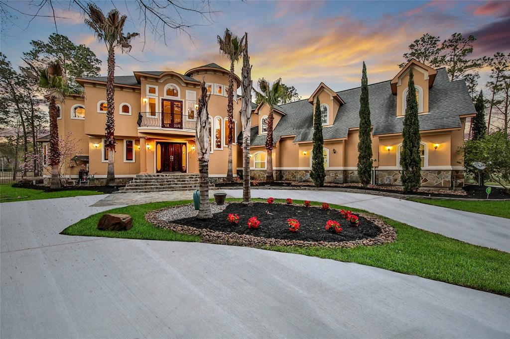 "This breathtaking home on the water is a ""MUST SEE"" for your list! If you love to entertain, this home is for you! The grand entertainer's entry opens into the gorgeous family room with spectacular views of the water through the curved wall of windows. Your family chef will love this gourmet kitchen with a large granite island, Thermador gas range, and huge walk-in pantry. Open to the family room with French Doors leading to your massive covered patio for easy outdoor dining while enjoying dazzling views of the lake. The regal master bedroom features wood flooring a tray ceiling, private patio access, and incredible master bath. Upstairs the gameroom is currently set up as a fantastic media room. Ideally situated over the garage, so turn up the fun as loud as you like! The outdoor space at this home is incredible! Enjoy vibrant views of the lake as you grill outside at the outdoor kitchen with the kiddos playing in the backyard. Sprinkler system. Oversized garage with workshop."