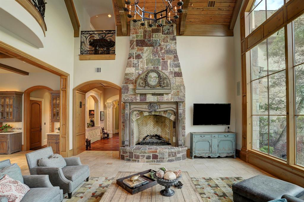 The fireplace in the Den is a true statement to the grand design of this home.
