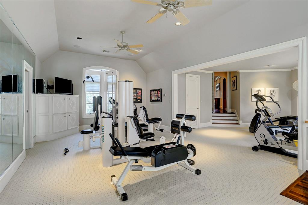 The second floor gym includes a guest room and full bathroom or could function as guest quarters.