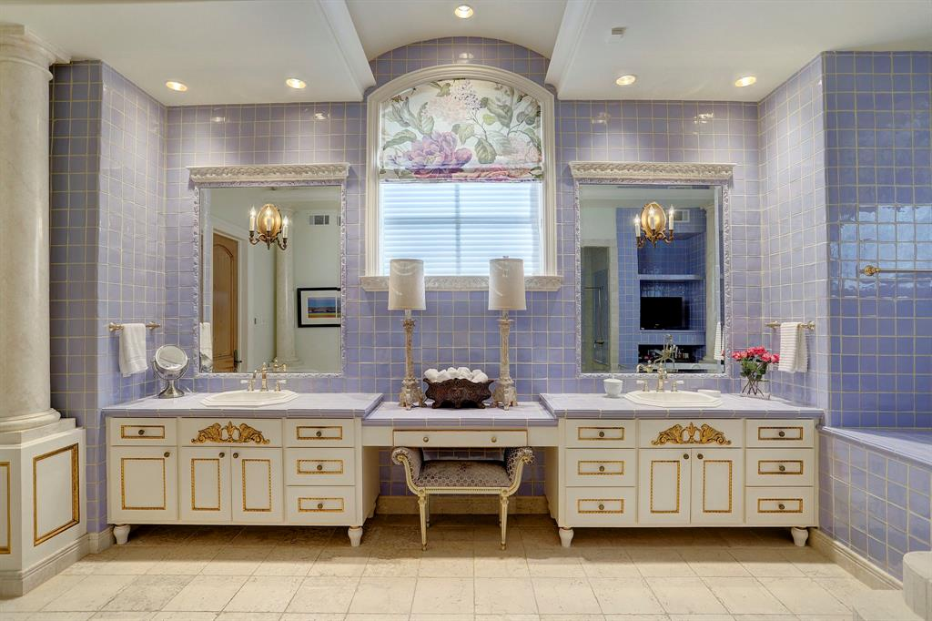 The Master Bathroom with separate tub and shower features dual sinks, vanity, and separate water closet.