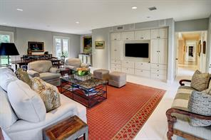 The custom built-in, with a storage closet behind, was added in the 2012-2013 renovation, along with the surround sound, making this an ideal room to watch movies or sports games.