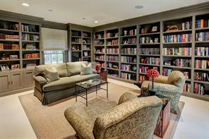 The corner LIBRARY (17'x14') located next to the Keeping Room offers a quiet retreat, with floor to ceiling built-in bookcases on three walls and lovely views of the yard.