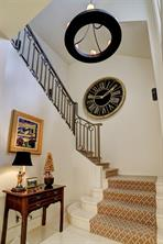 The staircase also has limestone treads and risers and a custom iron railing.