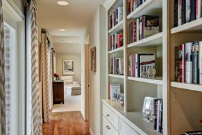 The Master Suite is located on the left wing.  The inviting ENTRY, with built-in bookcases, offers a nice transition between the second floor hall and the Master Bedroom.