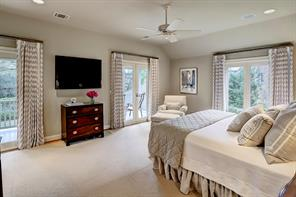 Double doors open to the expansive porch which overlooks the pool and pavilion.  The Master Bedroom also features the convenience of remote-controlled drapes.