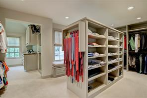Fantastic MASTER CLOSET (18'x11') with so much hanging space, a center island with shelves, and tie or belt racks on both ends.  A window seat offers convenient sitting space in front of the shoe storage area.