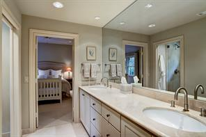 It also has an en-suite BATHROOM with two sinks and great storage space.