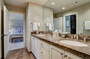 SECONDARY BATHROOM located between Bedroom #3 and Bedroom #4 has marble counters with double sinks, a separate walk-in shower with marble surround and Toto toilet.