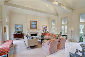 The expansive FORMAL LIVING ROOM (23'x22') located to the left of the Entry, has a gas log fireplace with elegant limestone mantle, surround and hearth.  Windows and doors with transoms on two sides offer great views of the grounds and fill the room with light.
